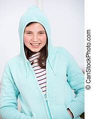 portrait of a smiling teenage girl with hood