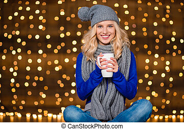 Portrait of a smiling woman drinking coffee