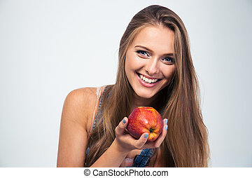 Portrait of a smiling woman holding apple