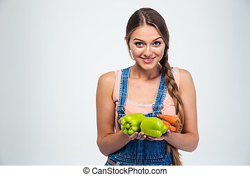 Portrait of a smiling woman holding vegetables
