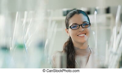 Portrait of a smiling woman in a lab