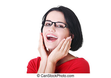 Portrait of a smiling woman in eyeglasses.
