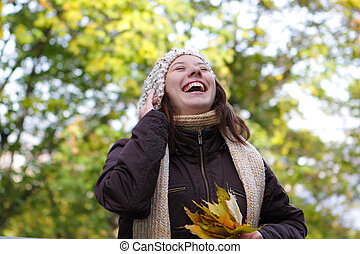 Portrait of a smiling woman in the forest