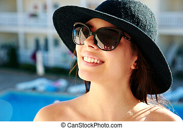 Portrait of a smiling woman outdoors