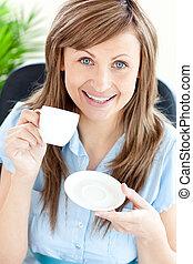 smiling woman taking coffee