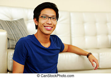 Portrait of a smiling young asian man at home
