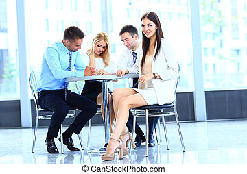 Portrait of a smiling young attractive business woman in a meeting