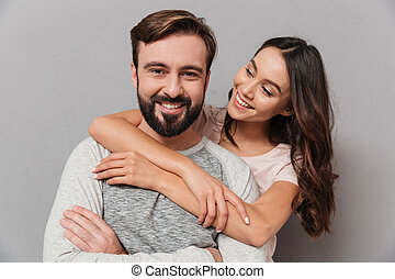 Portrait of a smiling young couple hugging
