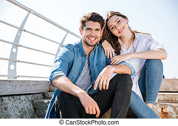Portrait of a smiling young couple looking at camera