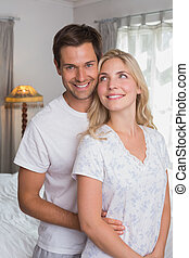 Portrait of a smiling young couple together