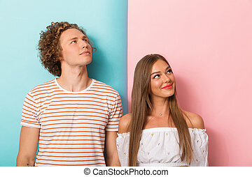Portrait of a smiling young couple standing