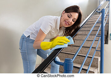 Female Janitor With Spray Bottle