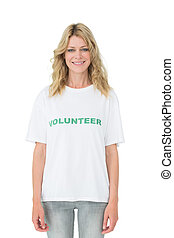 Portrait of a smiling young female volunteer standing over white background