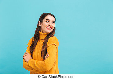 Portrait of a smiling young girl in sweater