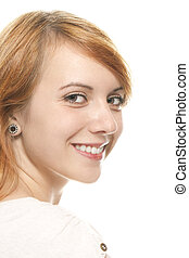 portrait of a smiling young redhead woman on white background