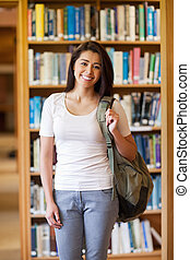 Portrait of a smiling young student standing up