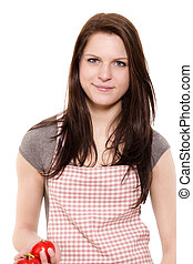 portrait of a smiling young woman with red apron holding tomatoes on white background