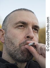 Portrait of a smoking beard man