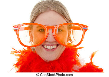 portrait of a soccer supporter with big orange glasses