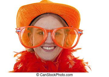 portrait of a soccer supporter with big orange glasses