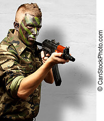 Portrait Of A Soldier Aiming With Gun