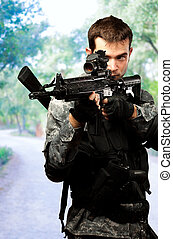 Portrait Of A Soldier Holding Gun