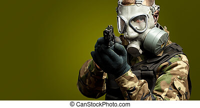 Portrait Of A Soldier With Gas Mask Aiming With Gun