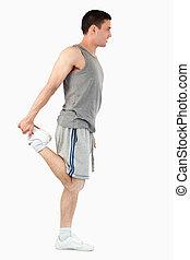 Portrait of a sports man stretching his leg