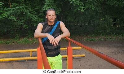 Portrait of a sportsman having a break after workout...