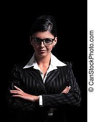 strict business woman on a black background