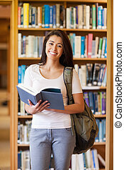 Portrait of a student holding a book