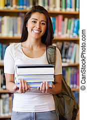 Portrait of a student holding books