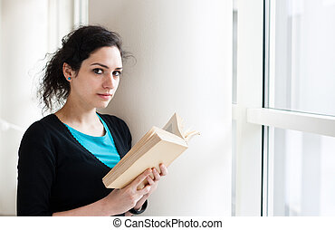 Portrait of a student reading a book