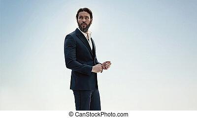 Portrait of a stylish man in an elegant suit