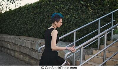 Portrait of a stylish woman in a black dress.