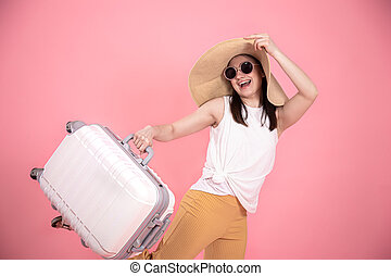Portrait of a stylish young woman in a hat with a suitcase on an isolated background .