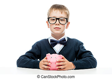 portrait of a successful boy with a piggy bank pink on a...