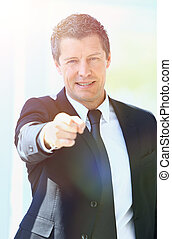 portrait of a successful businessman pointing forward