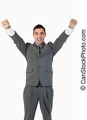 Portrait of a successful businessman against a white...