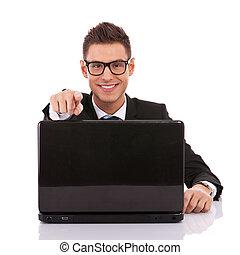 entrepreneur at his desk working on laptop - Portrait of a...