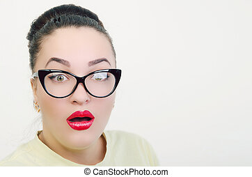 portrait of a surprised girl with glasses