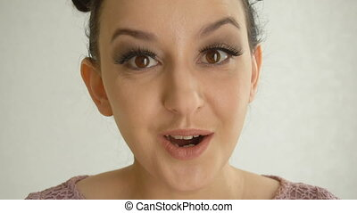 Portrait of a surprised girl with long false lashes and...