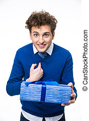 Portrait of a surprised man with gift over white background