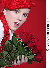 Portrait of a surprised woman holding roses