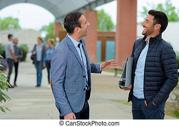 portrait of a teacher during conversation outdoors