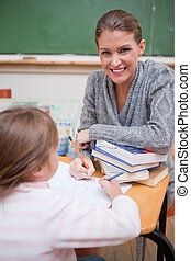 Portrait of a teacher explaining something to her pupil