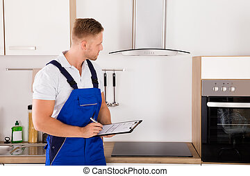 Portrait Of A Technician In Kitchen
