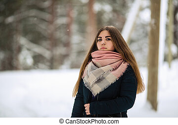 Portrait of a teen girl outdoors in winter.