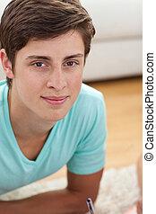 Portrait of a teen guy doing homework
