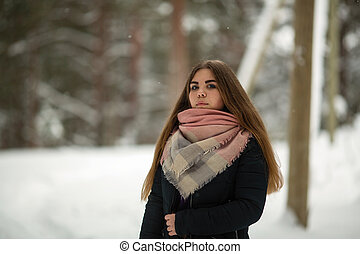 Portrait of a teen russian girl outdoors in the village at winter.